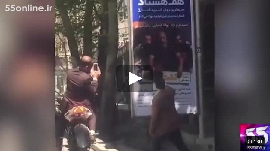 لحظه مخدوش شدن پوستر فیلم «گشت ۲» توسط افراد لباس شخصی